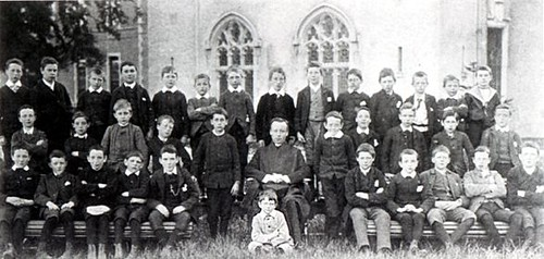 Clongowes Wood College class (Joyce seated in grass)