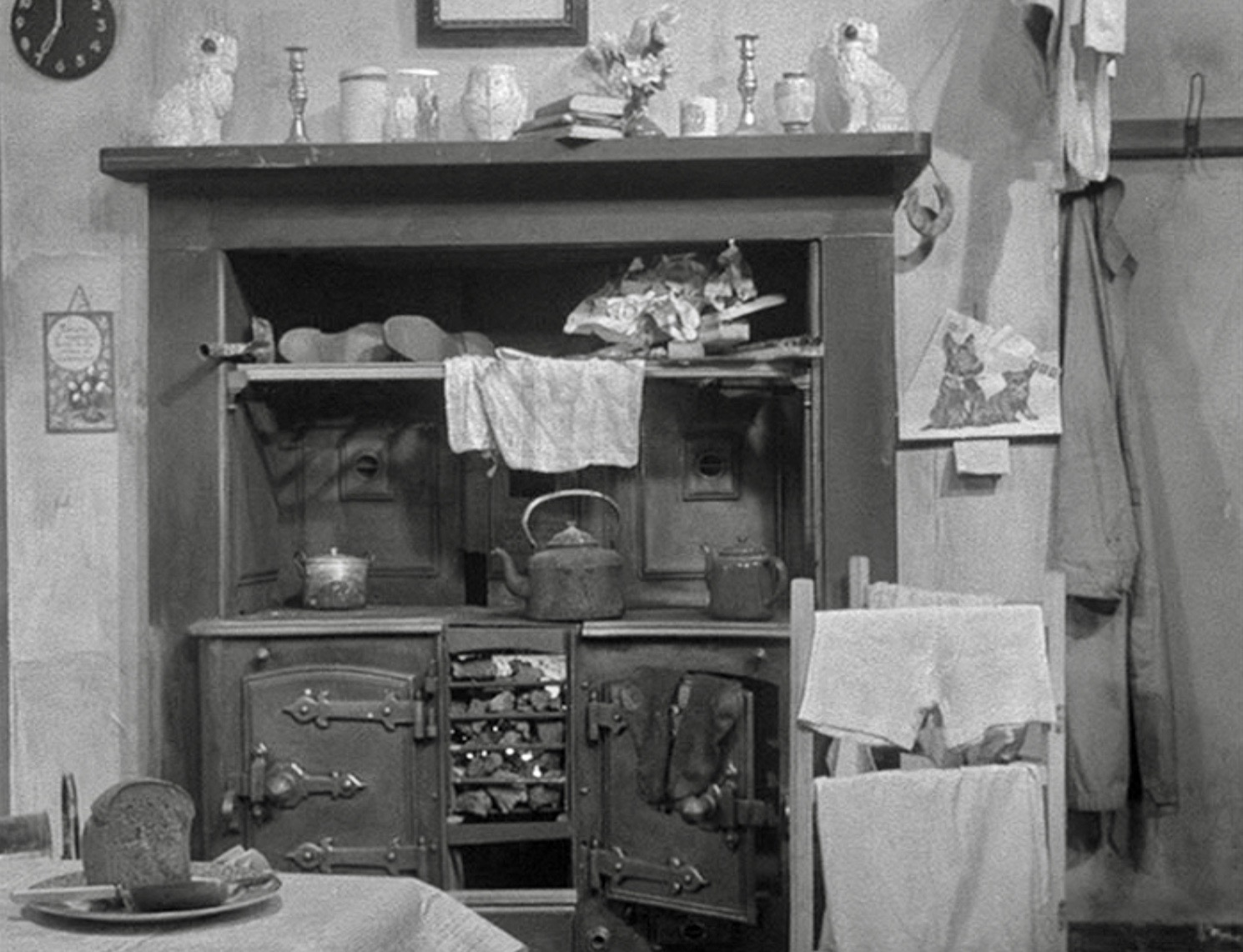A dark, crowded interior in need of updating in Mony a Pickle (1938).
