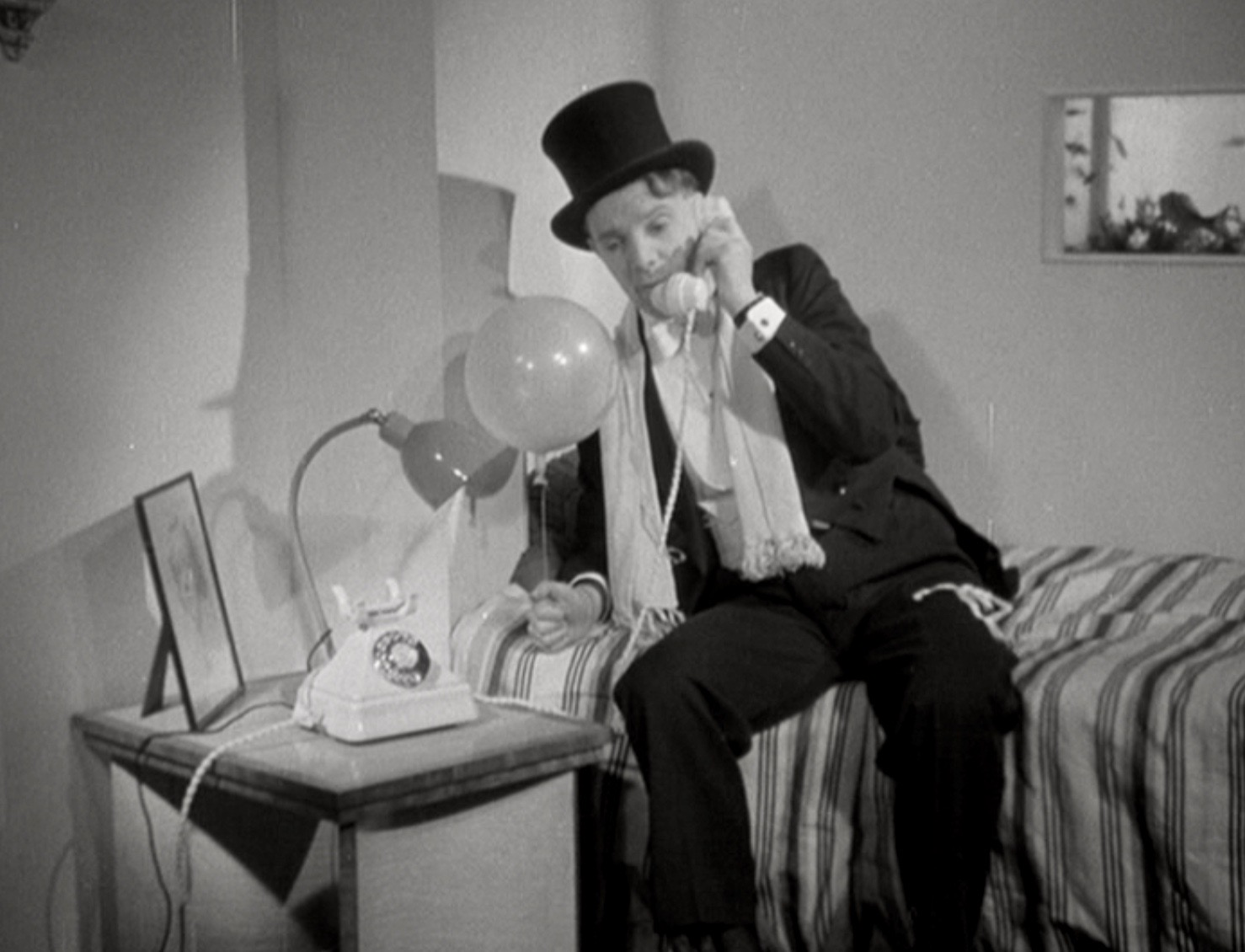 A Bright Young Thing learns that the home telephone can make modern life much easier in The Fairy of the Phone (1936).