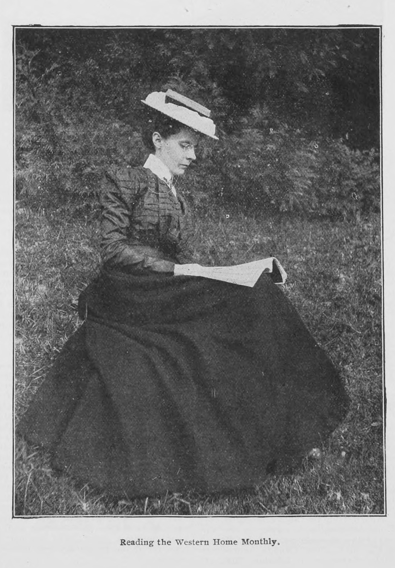 "Interior photograph, July 1907. ""Reading the Western Home Monthly."" Courtesy of Peel's Prairie Provinces (peel. library.ualberta.ca), a digital initiative of the University of Alberta Libraries."
