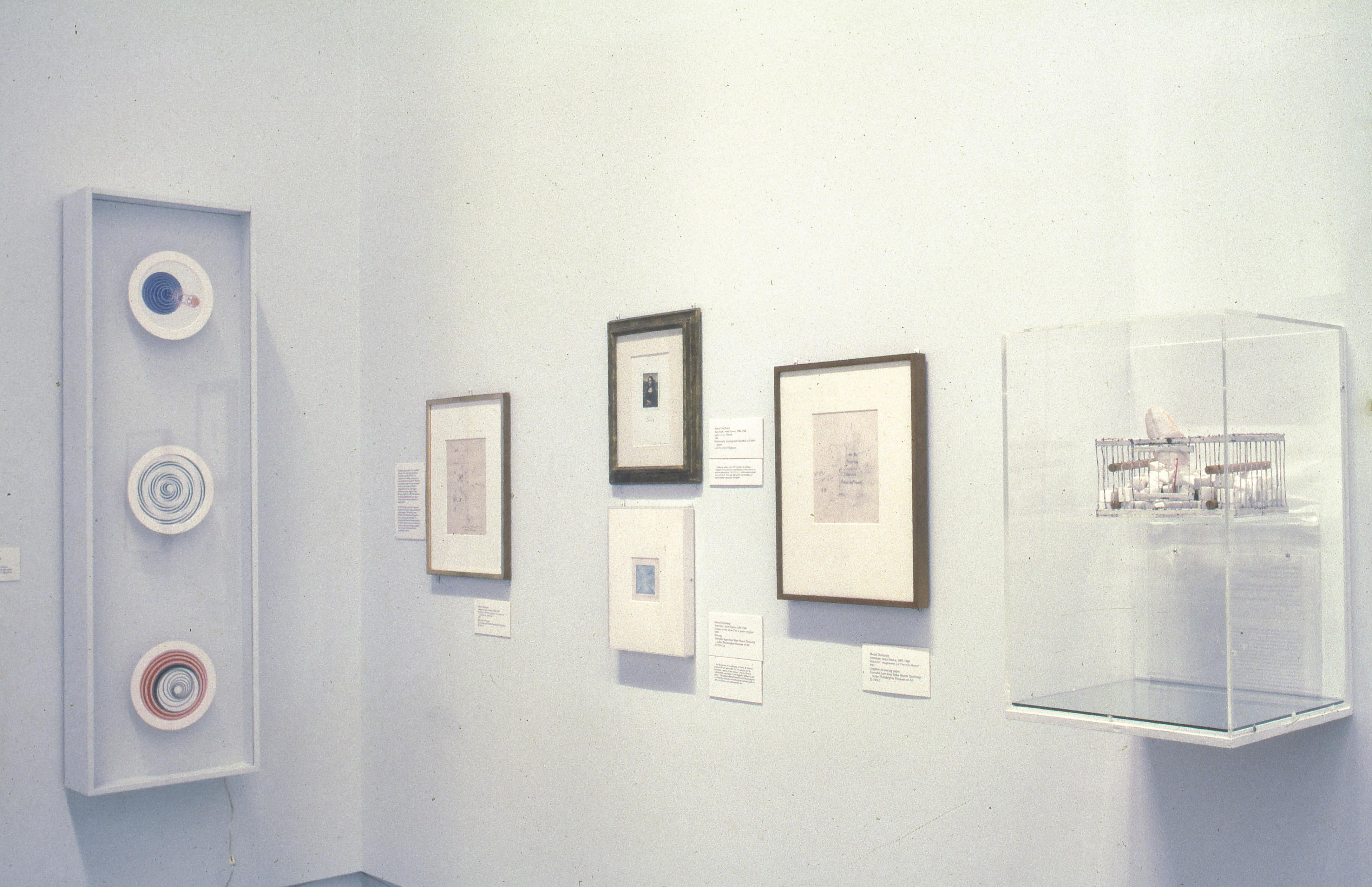 """""""Apropos of Marcel Duchamp 1887/1987"""" Exhibition, Philadelphia Museum of Art, 1987. Why Not Sneeze, Rose Sélavy? (1921) is on the right. Image courtesy Artstor."""