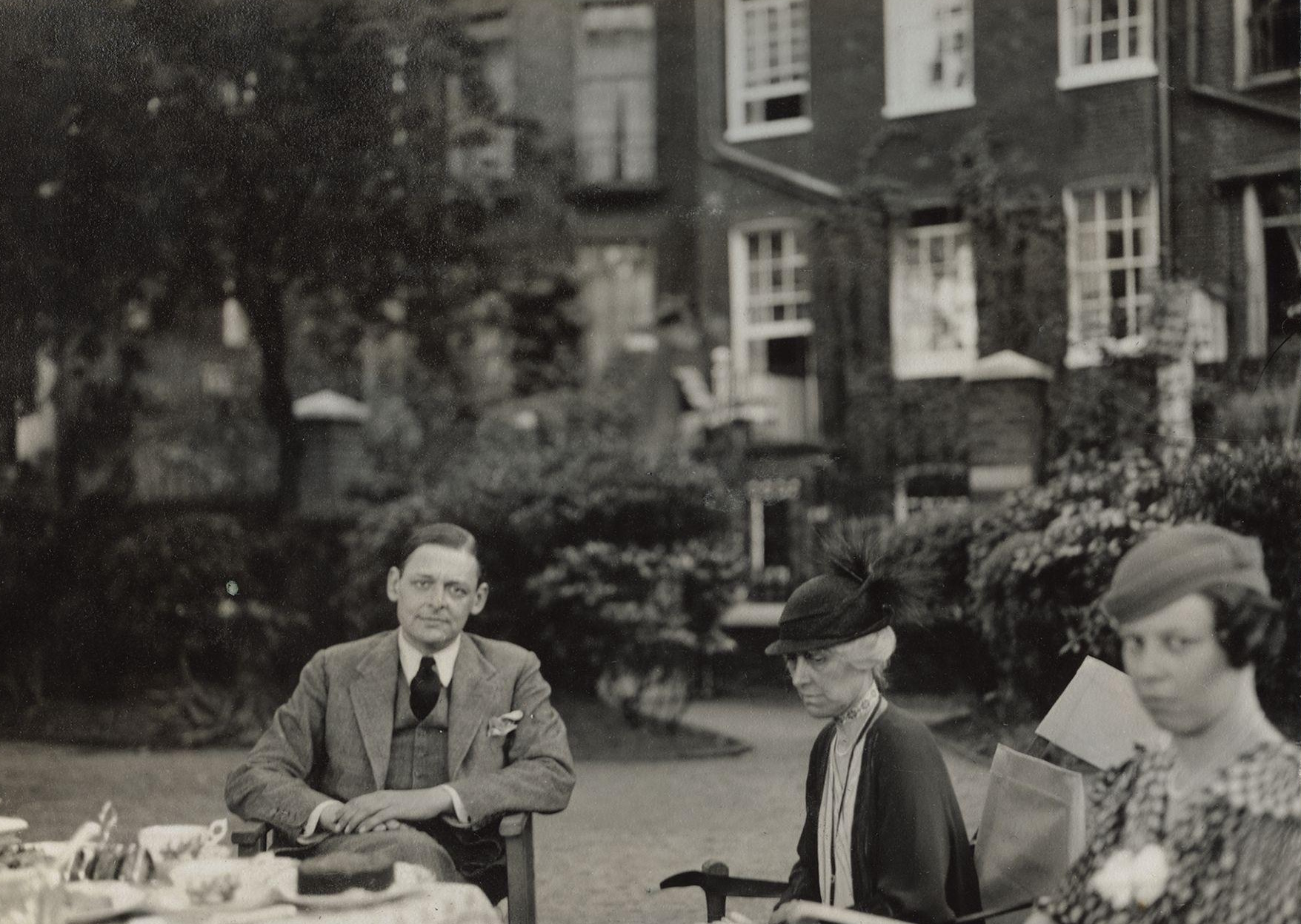 T. S. Eliot with his sister and cousin in 1934. Photograph by Lady Ottoline Morrell.