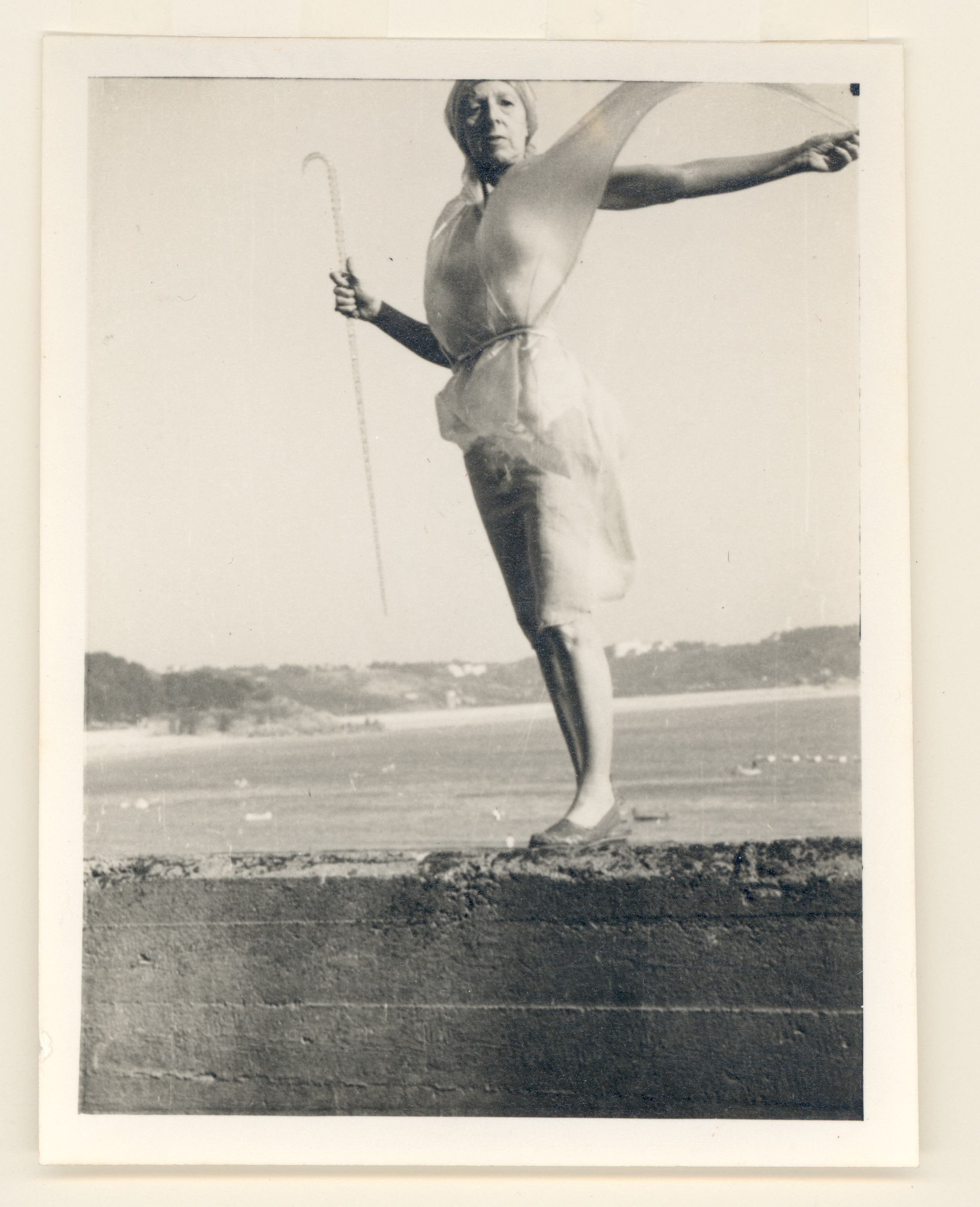 Claude Cahun and Marcel Moore, Self Portrait (on sea wall), 1947