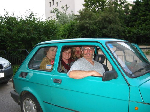 Family in maluch automobile