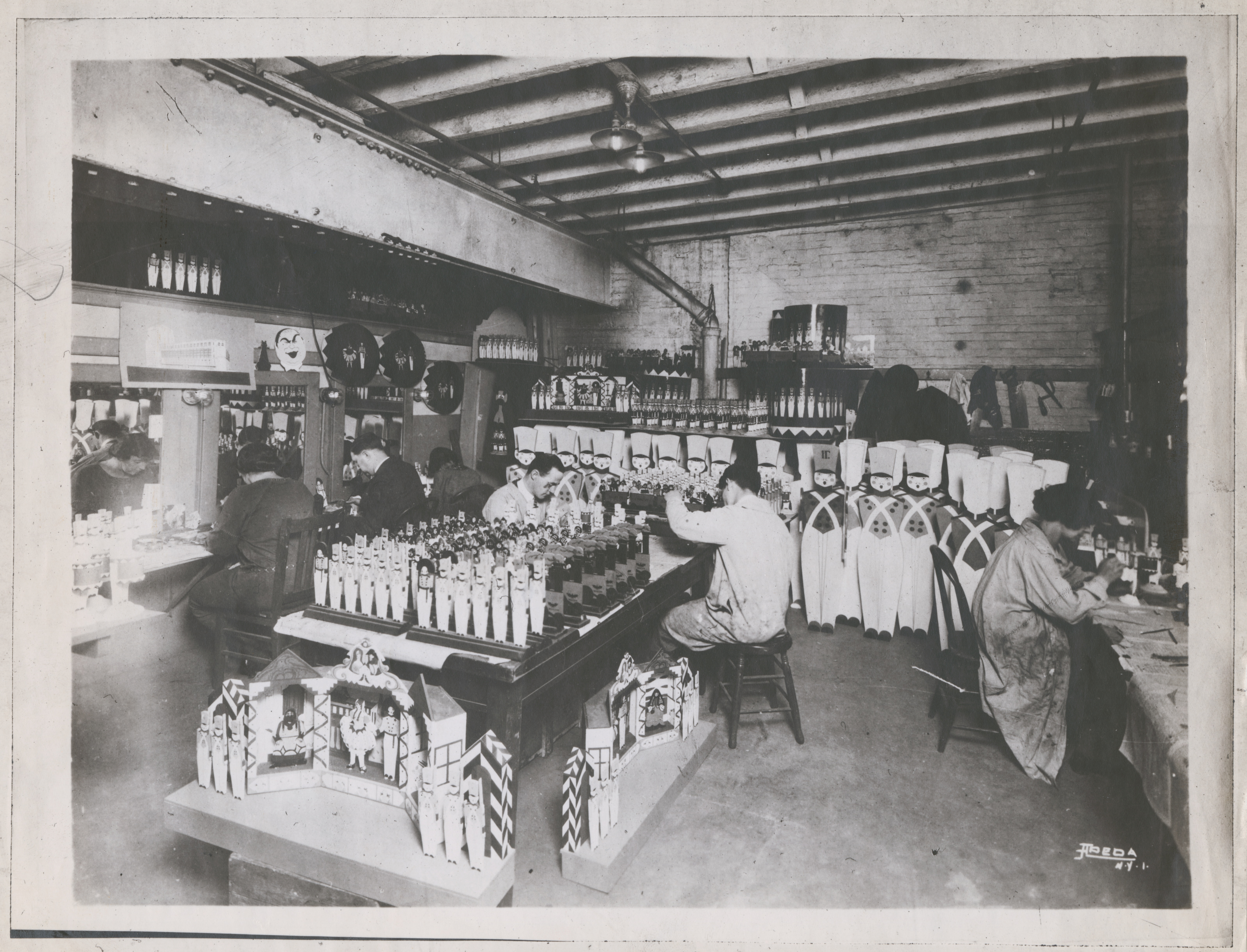 """A backstage workshop at the Princess Theater in New York, where artists are making props for """"The Parade of the Wooden Soldiers"""" (1922)."""