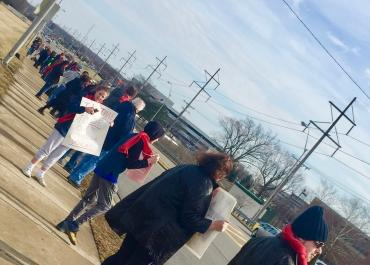 """Wright State faculty and allies join in a """"solidarity"""" line traversing the length of the Wright State campus entrance. Photo by the author."""